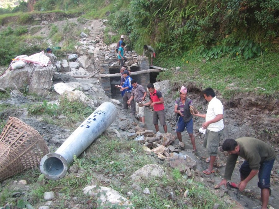 Local people and PEEDA staff collecting stones for construction